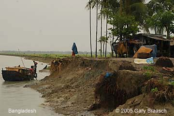Bangladesh erosion along river cuts a town in the middle, an increasing threat from global warming.