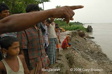 Bangladeshis point to where the town mosque stood just two months ago, as increasing river erosion is eating away at their town south of Dhaka.
