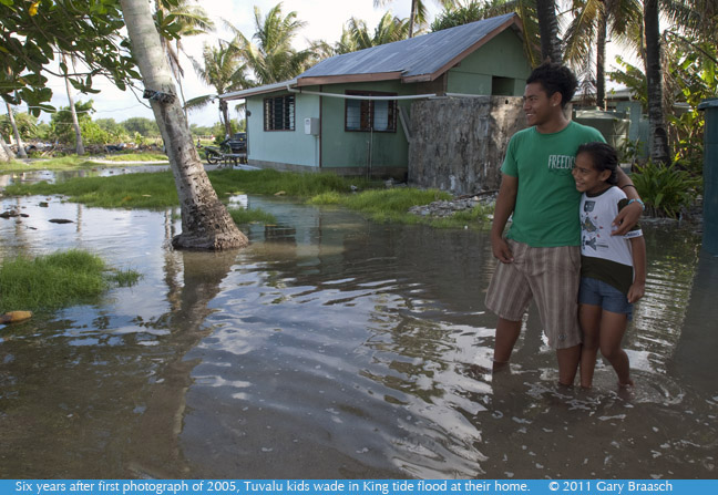 2011 photograph of Tuvalu kids waiting in King tide flood